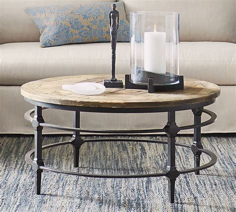Furniture showing off the beauty of the wood grain has a certain appeal and this chunky. Parquet Reclaimed Wood Round Coffee Table | Pottery Barn Canada
