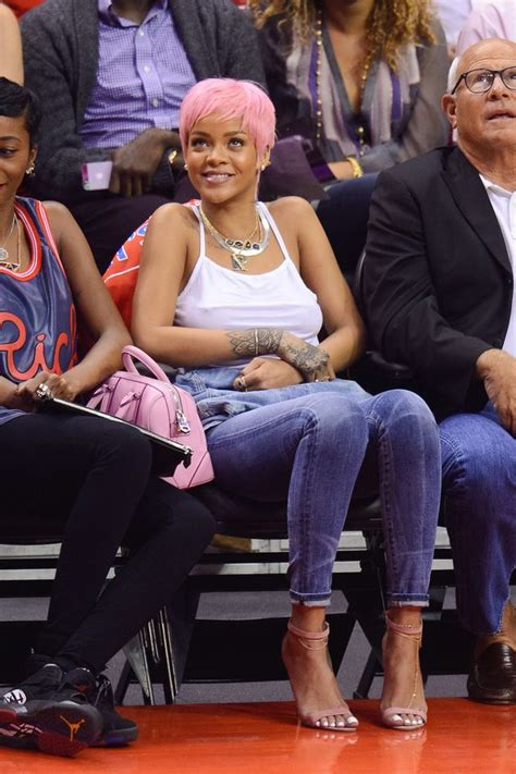 rihanna gropes  breasts courtside   shows