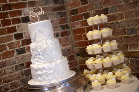 If you can dream it, they can make it. White Floral 3 Tier Wedding Cake with Cupcake Tower ...