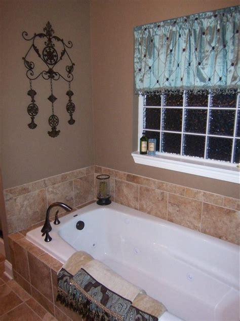 drop  soaking tub  corner faucet master tub
