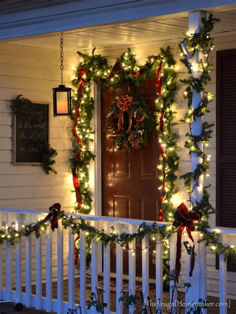 christmas front porch  hanging candle lanterns