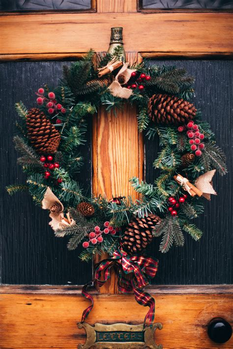 green  red christmas wreath  door  stock photo