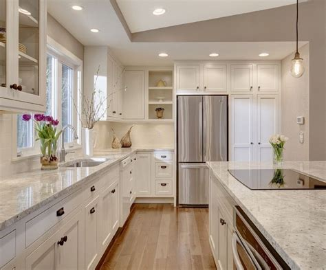 kitchen with an island kitchen island with cooktop in kitchen transitional with 6488