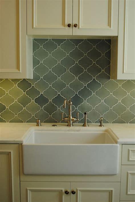 cream backsplash with white cabinets cream cabinets brass hardware green arabesque tile