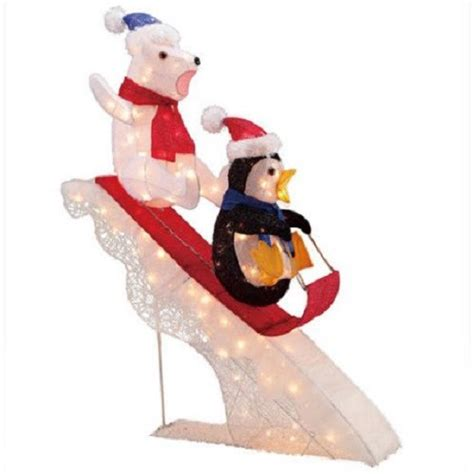tis  season  polar bear  penguin sledding