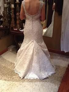 Over bustle with a mermaid style lace wedding gown for How to bustle a lace wedding dress