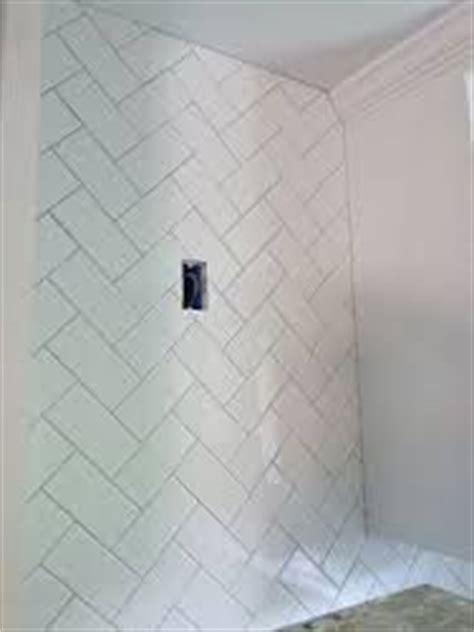 4 x 16 subway tile in shower in herringbone pattern