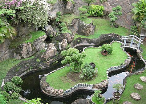 kolam ikan mungil  rumah minimalis sebagai penyegar