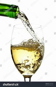 White Wine Pouring Into Glass Stock Photo 76902928 ...