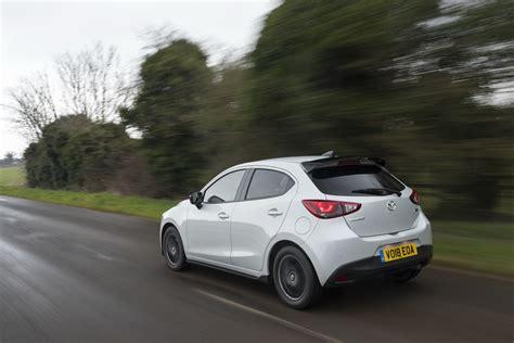 Mazda 2 2021 thực chất chỉ là phiên bản nâng cấp giữa chu kỳ, song vẫn sở hữu nhiều chi tiết mới. 2018 Mazda2 Gets Sport Black Limited Edition With Aero Kit ...