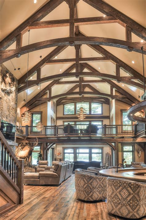arched king post trusses   dark stain give  great room  cathedral ceiling  high