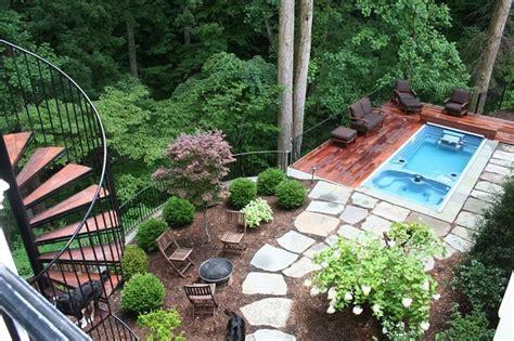 swimming pool and deck on steep slope in mclean backyard
