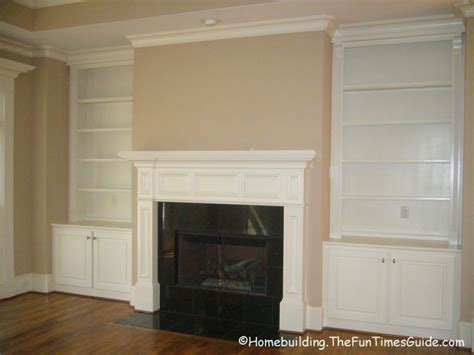 built in bookcases around fireplace were there was just a fire place with a really nice mantle