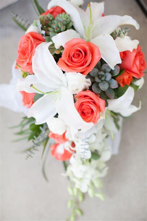 coral cascade bride bouquet white lilies succulents