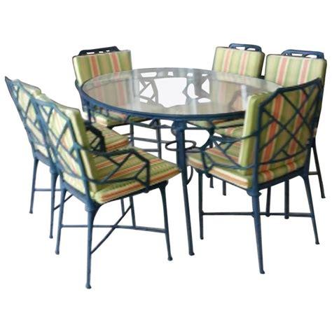 9 pc brown calcutta patio set dining table arm