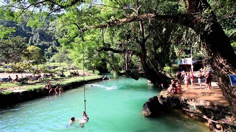 Santas Jumping Into The Blue Lagoon In Vang Vieng Laos