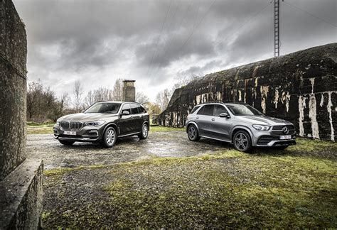2020 mercedes gle how does it stack up to the audi q7 bmw x5. Test BMW X5 45e vs Mercedes GLE 350 de 2020 - AutoGids