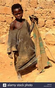 Kala Tanzania. Girl in ragged clothes holding a stick; Lake Stock Photo Royalty Free Image ...