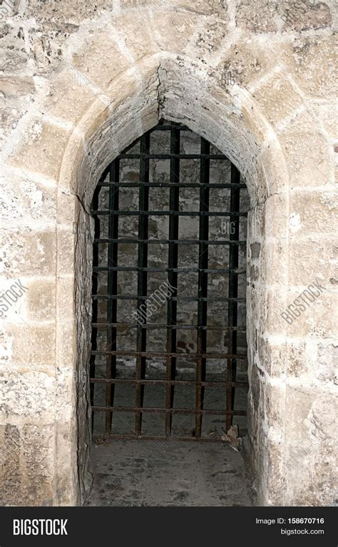 middle ages portal bars dungeon image photo bigstock