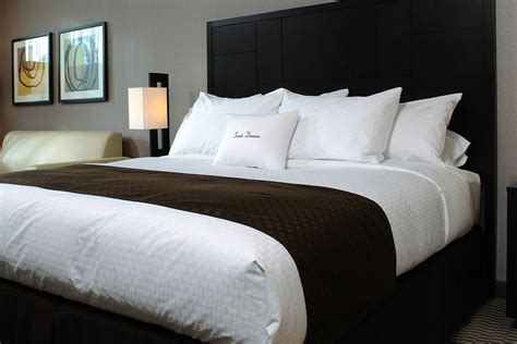 Bed Scarves  Doubletree At Home. Small Clawfoot Tub. Floral Sofa. Industrial Crystal Chandelier. Grey Wood Floors. Limestone Backsplash. Orange Leather Sofa. Serene Homes. French Dresser