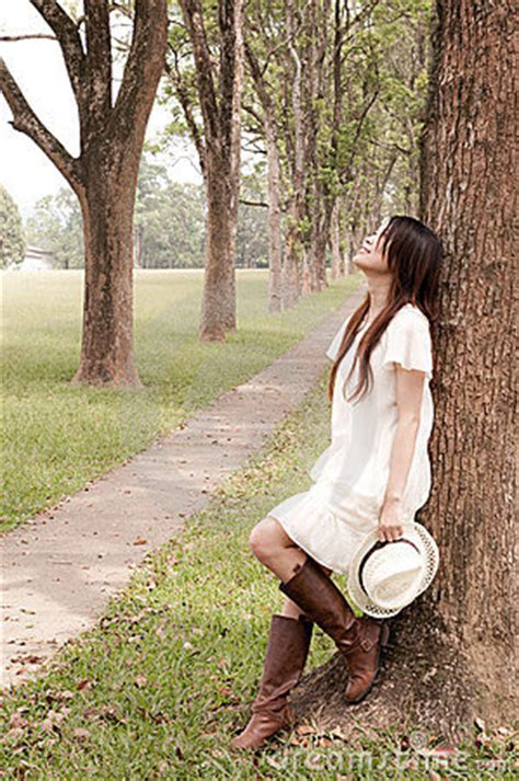 young girl leaning   tree stock image image