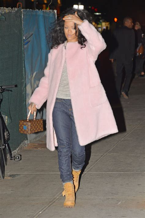 rihanna carries louis vuitton bag designed  franky gehry purseblog