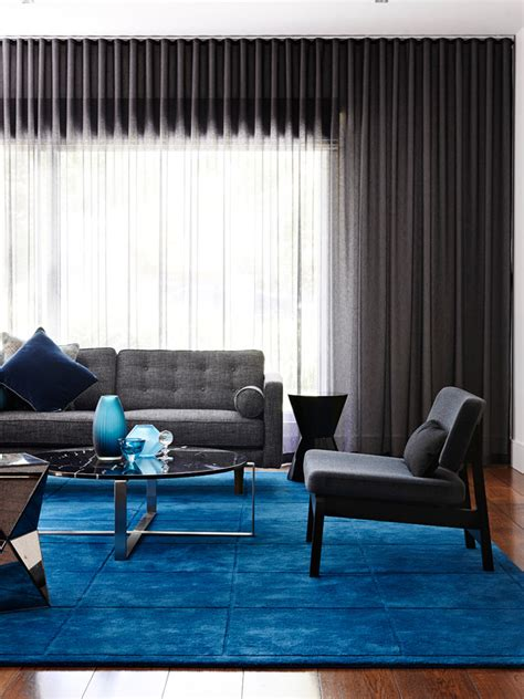 impressive mohawk area rugs in living room contemporary with blue carpet next to area rug on