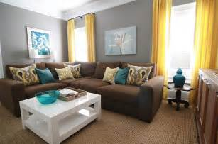 brown gray teal and yellow living room with sectional sofa and white coffee table house