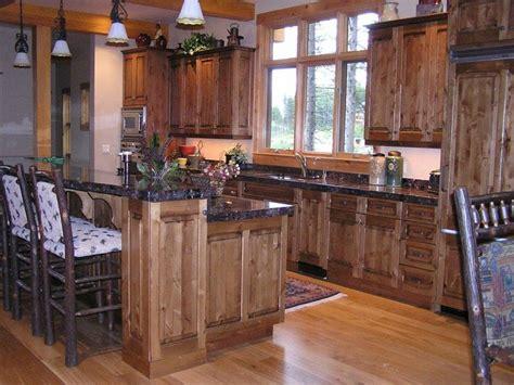 rustic kitchen  dark knotty alder cabinets bathroom cabinets sundance cabinet design