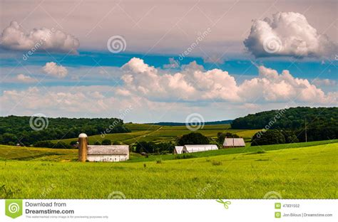 Beautiful Summer Sky Over Barn And Farm Fields In Southern