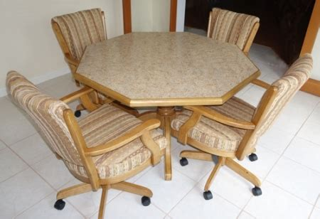 dining table with rolling chairs dinettes dining room furniture tables matching chair