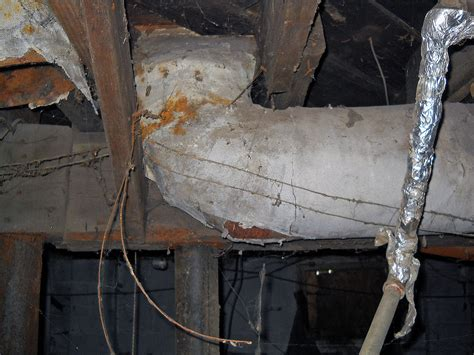 damaged asbestos insulation  home duct closer view