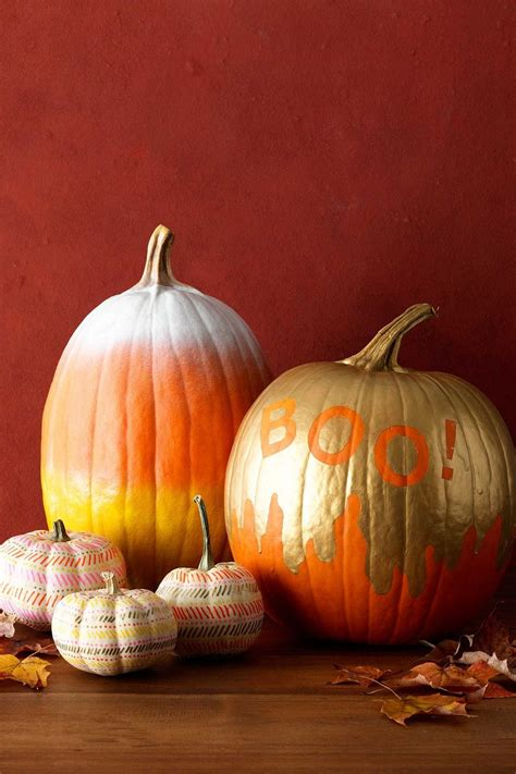 painting a pumpkin 25 awesome painted pumpkin ideas for halloween and beyond