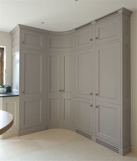 Curved Cupboard Doors by Corner Pantry With Convex Curved Doors Grey Kitchen