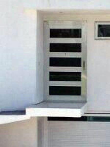 foto puerta linea europea de aluminio  vidrio mtz