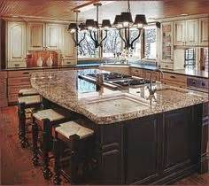 www kitchen designs 25 best ideas about kitchen island with stove on 1676