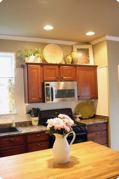 Ideas For On Top Of Kitchen Cabinets by Simple Decorating Above Kitchen Cabinets Decorating