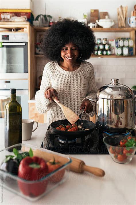 beautiful black woman cooking   home  santi nunez