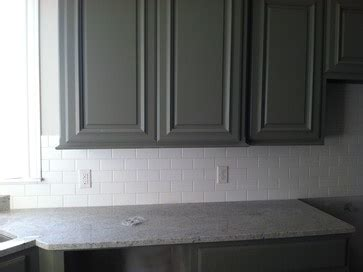 white matte  subway tile dark greengray cabinets