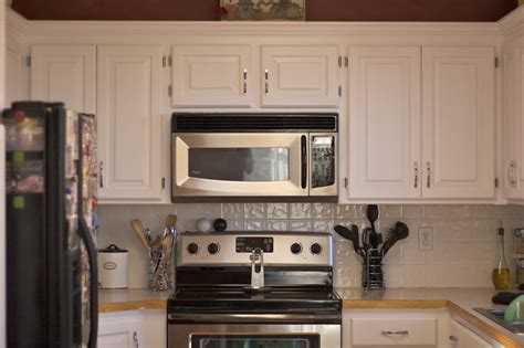 painting cherry kitchen cabinets white best repainting kitchen cabinets loccie better homes