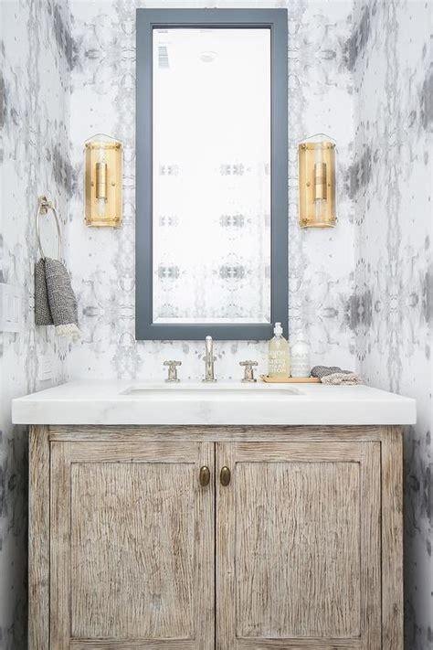 gray powder room wallpaper  light brown washstand