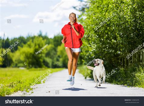 young attractive sport girl running  dog  park stock