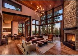 Hardwood Floors Sunken Living Room by Rustic Living Room With High Ceiling Stone Fireplace In TRUCKEE CA Z