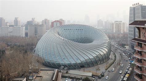 Architecture : The Beijing Tv Studio Is Wrapped Up In A Doughnut-shaped