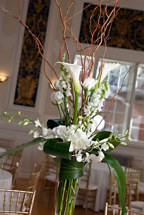 willow arrangement curly willow arrangements lilies white dendrobium orchids roses curly willow and