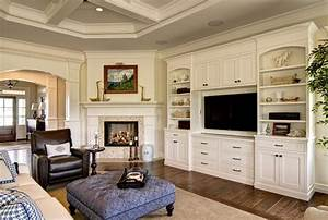 Delightful Fireplace Built in Cabinets with Brown Ottoman