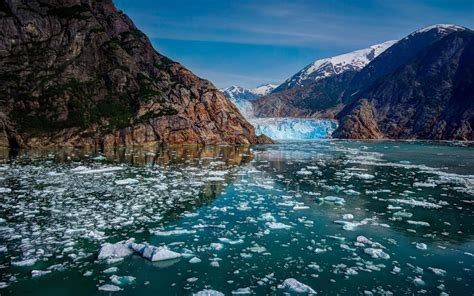 mountain lake floating pieces  ice rocky mountains