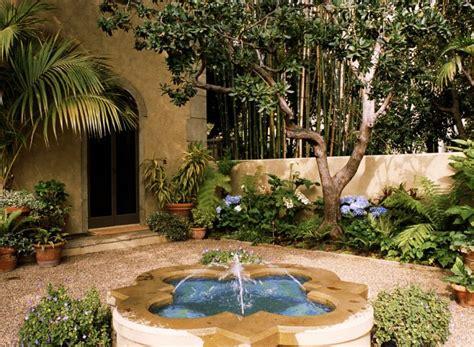 italian mediterranean garden  small fountain   center  beautiful surrounding