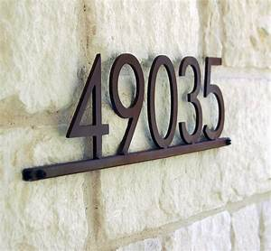 modern metal address plaque with five 5 in steel house With house numbers and letters