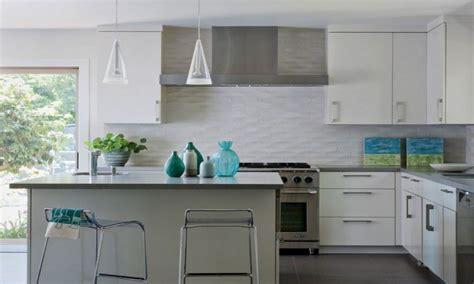 wavy geometric tile kitchen backsplash ideas  white cabinet